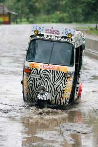 Auto rickshaw in floodwater